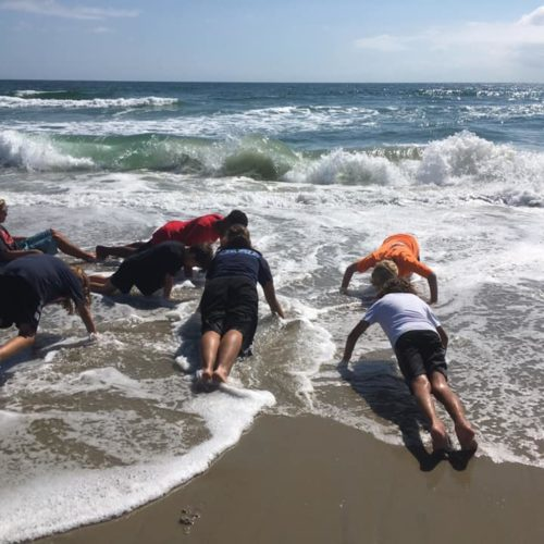 OBX Martial Arts Students doing Pushups on the Beach
