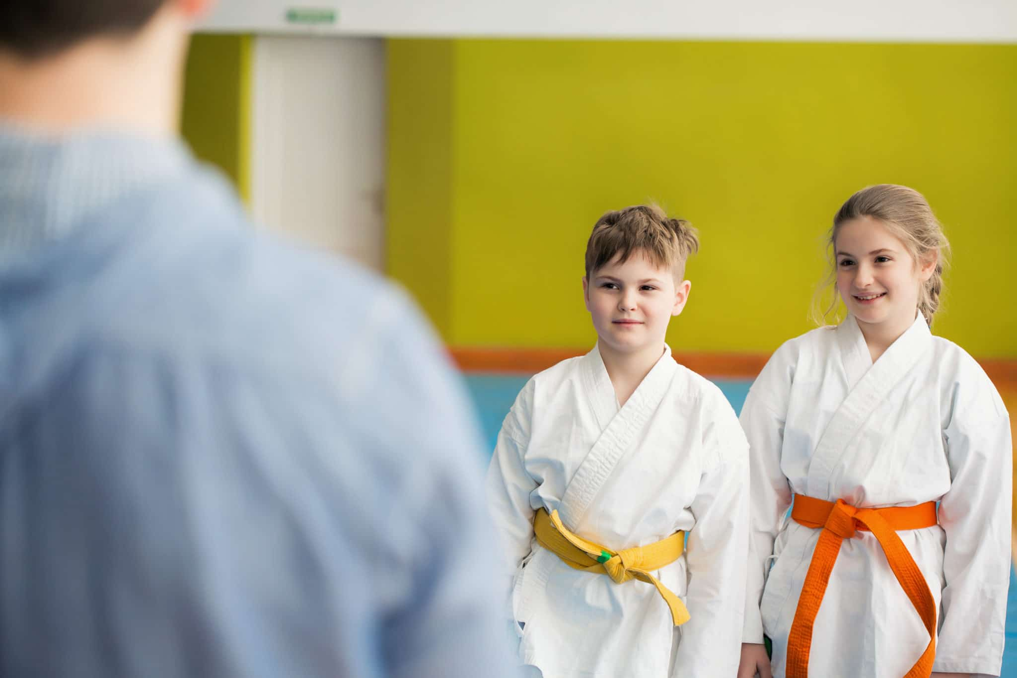 Father waiting for his kids training martial arts
